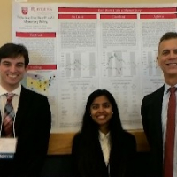 Professor Eugene White and two of his ARESTY research assistants, Kruttika Raman and Tracy Ryan